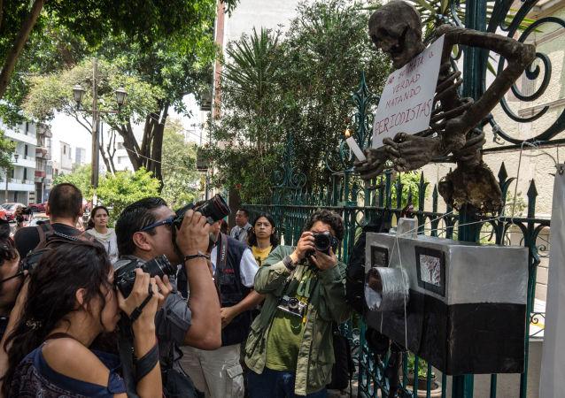Una manifestación en protesta al asesinato de periodistas en México