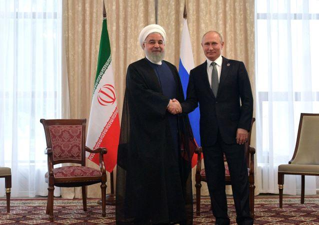 El presidente iraní, Hasán Rohaní, y el presidente ruso, Vladímir Putin