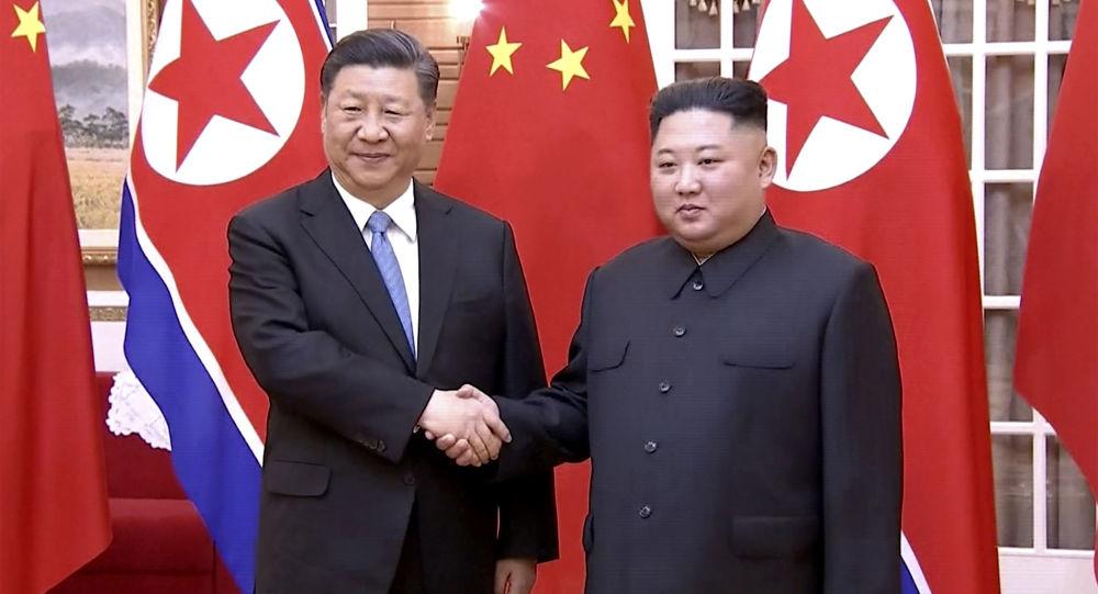 El presidente de China, Xi Jinping, y el líder norcoreano, Kim Jong-un
