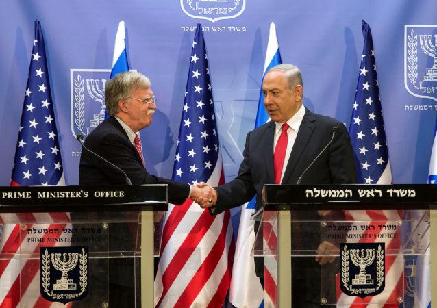 Consejero de Seguridad Nacional de la Casa Blanca, John Bolton, y primer ministro de Israel, Benjamín Netanyahu