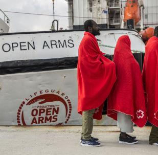 Barco Open Arms y migrantes