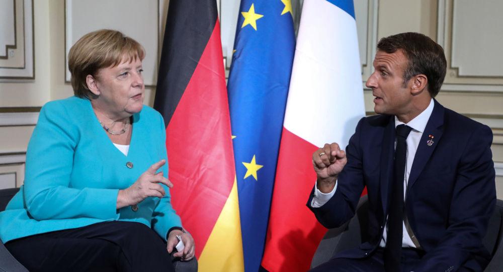 Angela Merkel, canciller de Alemania, y Emmanuel Macron,  el presidente de Francia