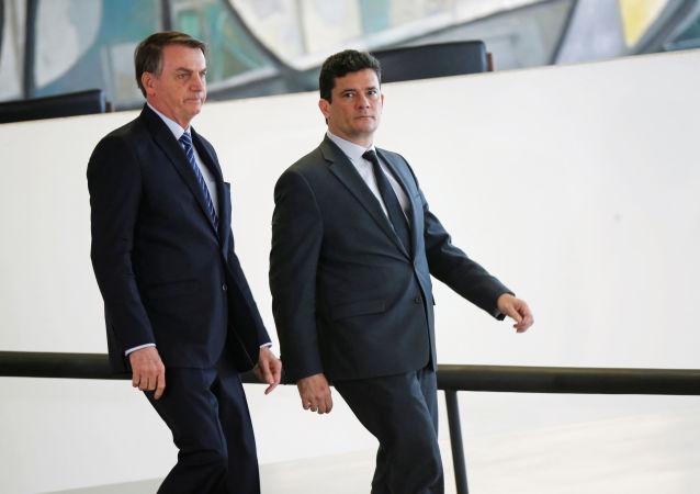 El ministro de Justicia y Seguridad Pública de Brasil, Sérgio Moro y el presidente brasileño, Jair Bolsonaro