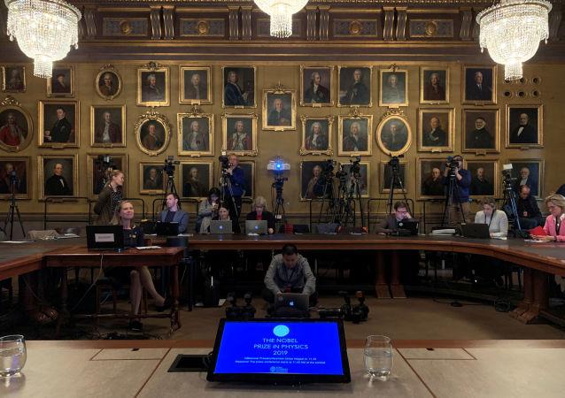Los periodistas a la espera de la entrega del Premio Nobel de Física 2019