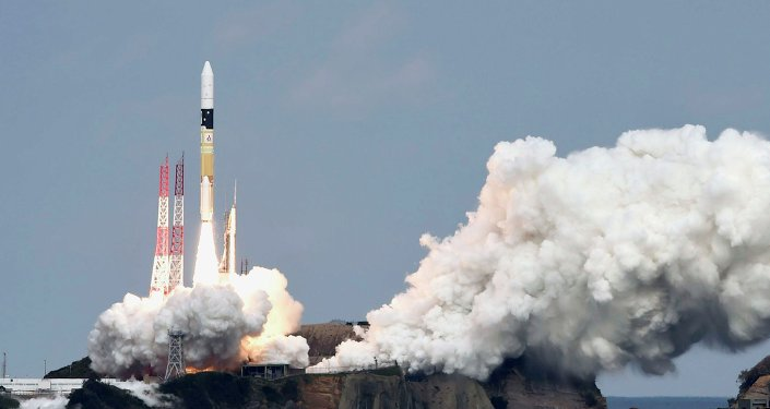 A H-IIA rocket carrying Hayabusa 2 space probe blasts off from the launching pad at Tanegashima Space Center on the Japanese southwestern island of Tanegashima, in this photo taken by Kyodo December 3, 2014.