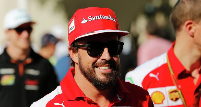 Ferrari Formula One driver Fernando Alonso of Spain arrives for a press conference at the Yas Marina circuit before the start of the Abu Dhabi Grand Prix November 20, 2014.