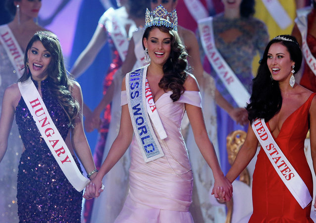 Miss South Africa Rolene Strauss, centre, celebrates after being crowned Miss World 2014, during the finale of the competition at the ExCel centre in London, Sunday, Dec. 14 2014.