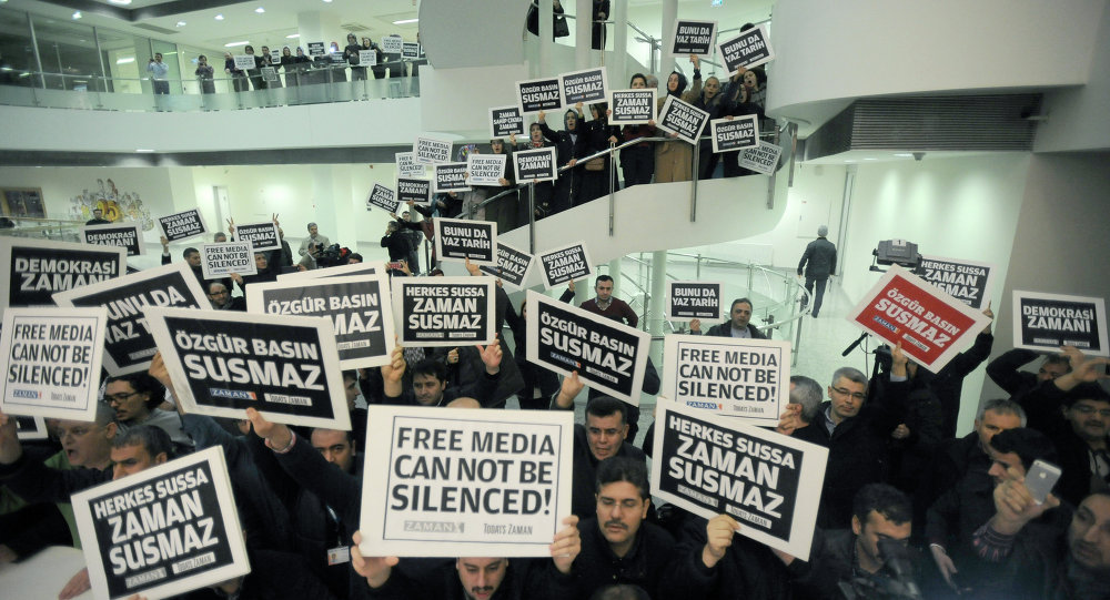 People gather in support inside the headquarters of Zaman newspaper in Istanbul, Turkey, Sunday, Dec. 14, 2014