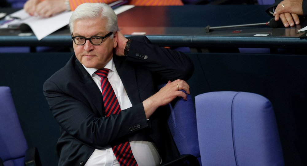 Germany's Foreign Minister Frank-Walter Steinmeier sits on his chair at the lower house of parliament Bundestag in Berlin, November 26, 2014.