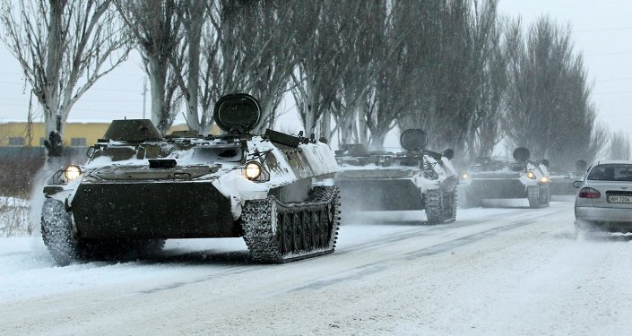 Unmarked armored personnel carriers (APC) are seen on the road from Luhansk to Donetsk in the territory controlled by the self-proclaimed Donetsk People's Republic, eastern Ukraine, December 1, 2014