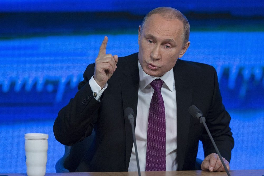 Russian President Vladimir Putin gestures during his annual news conference in Moscow