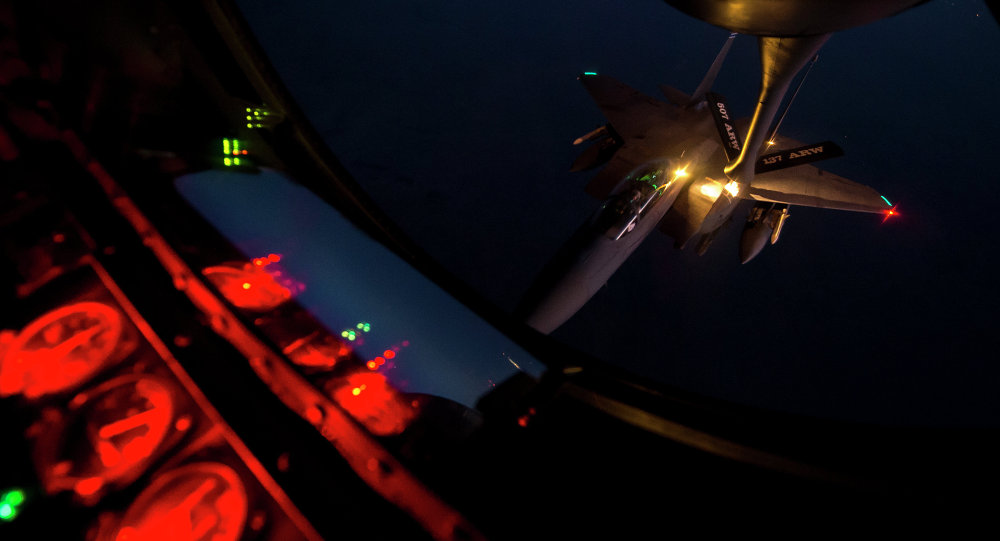 A U.S. Air Force F-15E Strike Eagle aircraft refuels from a KC-135 Stratotanker aircraft over northern Iraq Sept. 23, 2014