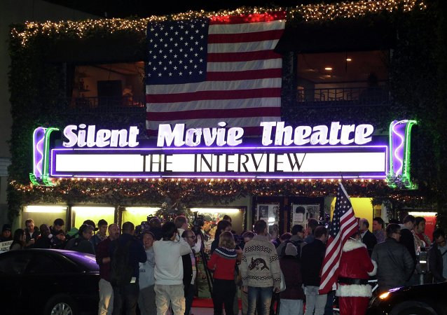 Fans line up at the Silent Movie Theatre for a midnight screening of The Interview in Los Angeles, California