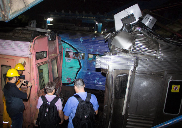Engineers from Supervia train service inspect the two commuter trains which collided at the Presidente Juscelino train station injuring 158 people, in Mesquita, 34 km from Rio de Janeiro
