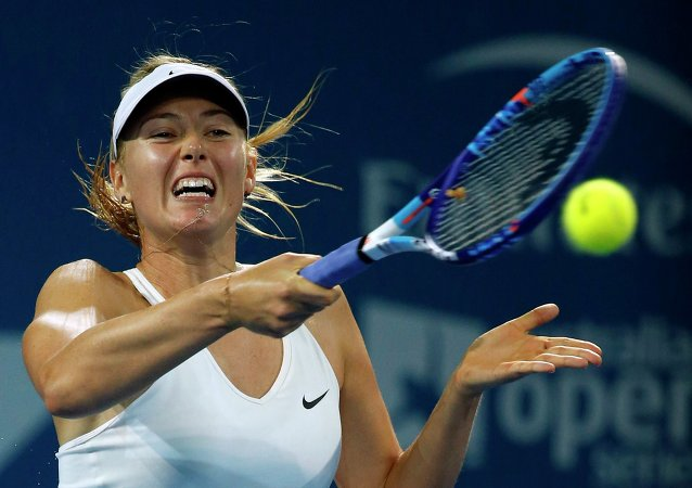 Maria Sharapova of Russia plays a forehand return to Ana Ivanovic of Serbia during their women's singles final match at the Brisbane International tennis tournament in Brisbane, January 10, 2015.