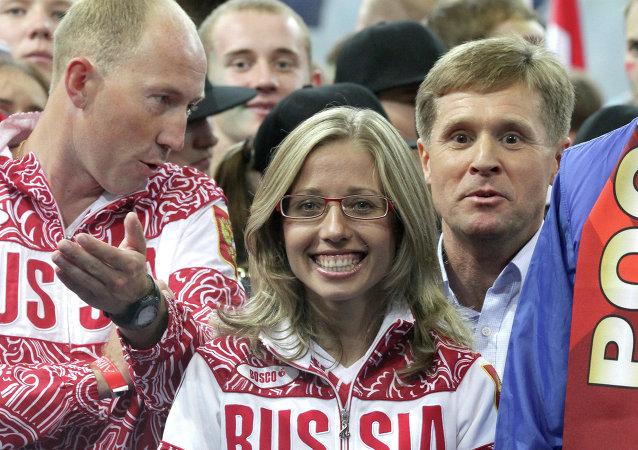 Serguéi Kirdyapkin, Olga Kaniskina y su entrenador Victor Cheguin