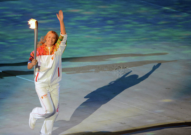 María Sharapova lleva llama olímpica