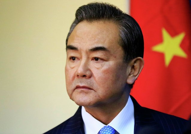 China's Foreign Minister Wang Yi listens during a meeting with Sudan's Foreign Minister Ali Karti in Khartoum January 11, 2015