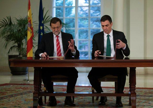 Presidente del Gobierno español, el conservador Mariano Rajoy, y el líder de la oposición, el socialista Pedro Sánchez