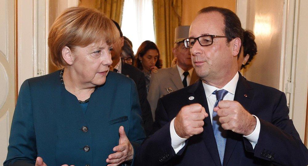 Canciller de Alemania, Angela Merkel, y el presidente de Francia, François Hollande
