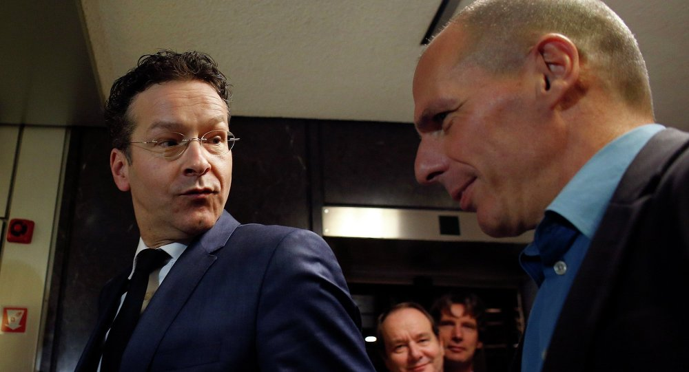 Jefe de Eurogrupo, Jeroen Dijsselbloem y ministro de Finanzas de Grecia, Yanis Varoufakis