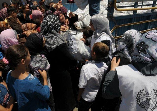 Distribución de ropa para refugiados de Siria