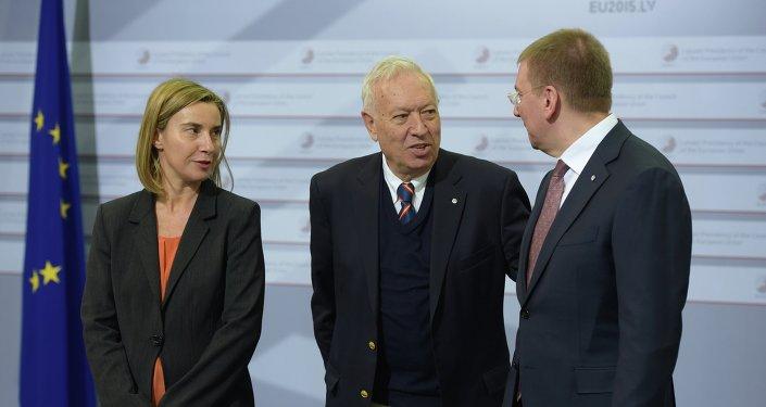 Fedreica Mogherini, José Manuel García-Margallo y Edgars Rinkevics