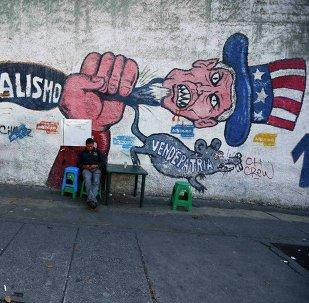 Un graffiti antiamericano en Caracas