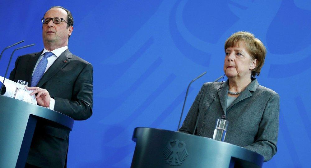 François Hollande, presidente de Francia y Angela Merkel, canciller de Alemania