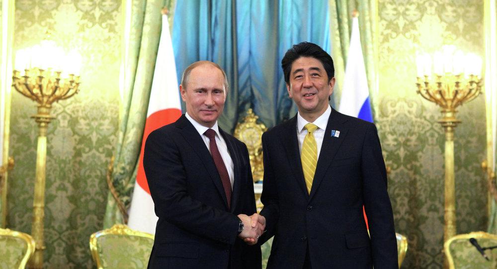 Presidente de Rusia, Vladímir Putin y primer ministro de Japón, Shinzo Abe