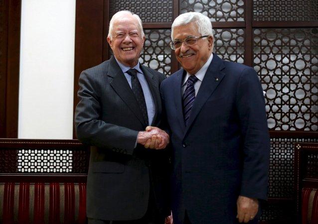 Expresidente estadounidense, Jimmy Carter y presidente palestino, Mahmud Abás