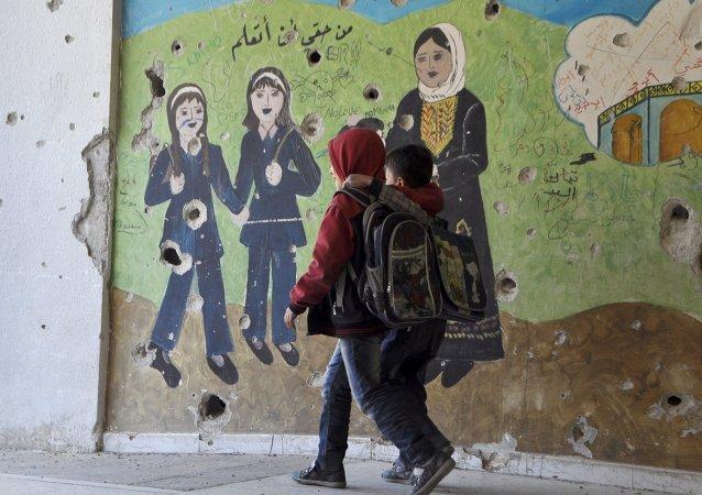 Niños en el campo de refugiados Yarmuk