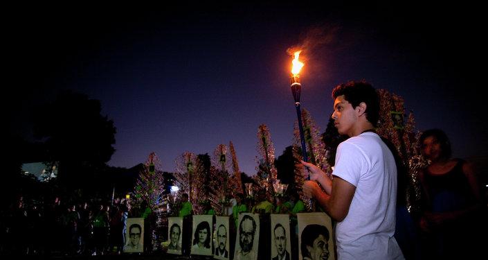 Una manifestación en homenaje al jesuita español Ignacio Ellacuría y otras ocho personas, asesinadas en El Salvador en 1989.