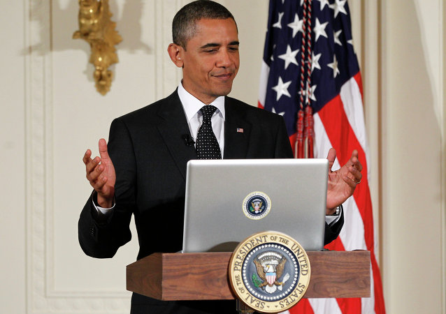 President Barack Obama tweets during a Twitter Town Hall in the East Room of the White House in Washington, Wednesday, July 6, 2011