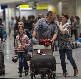Personas evacuadas desde Siria en el aeropuerto de Domodédovo