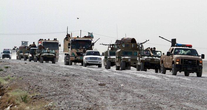 Paramilitares chiítas viajan hacia Ramadi para luchar contra el Estado Islámico