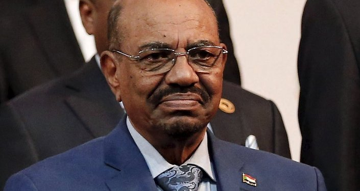 Sudan's President Omar al-Bashir prepares for a group photograph ahead of the African Union summit in Johannesburg June 14, 2015