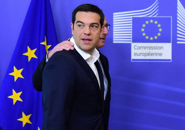 Primer ministro de Grecia, Alexis Tsipras, y presidente de la Comisión Europea, Jean-Claude Juncker