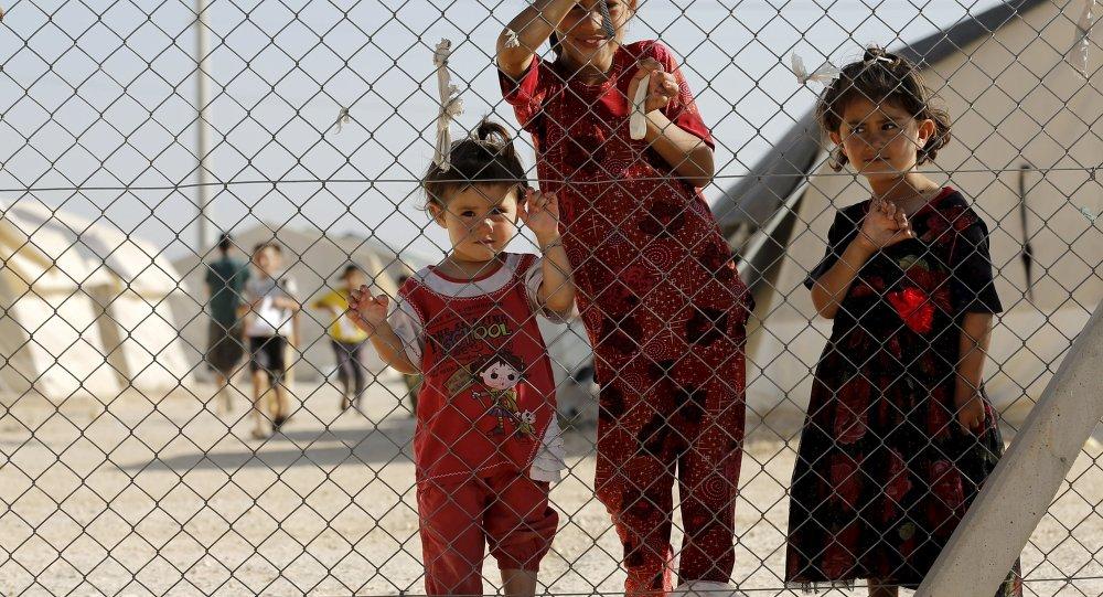 Niños en el campo de refugiados sirios e iraquíes en Midyat, Turquía, el 20 de junio, 2015