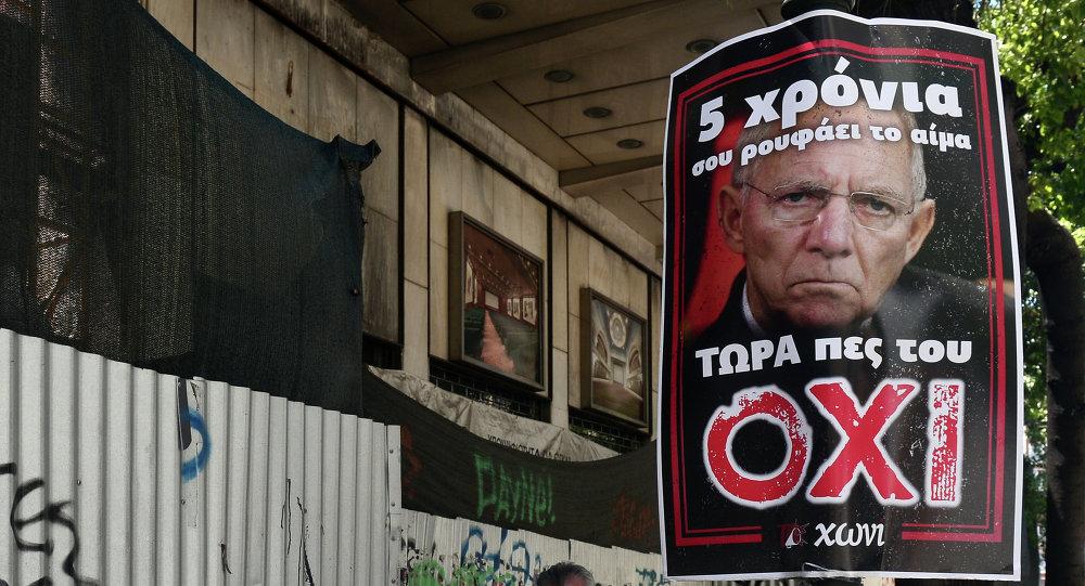 Póster con la imágen de Wolfgang Schäuble en Atenas