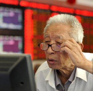 Inversionista en una casa de corretaje en Fuyang, China, el 9 de julio, 2015