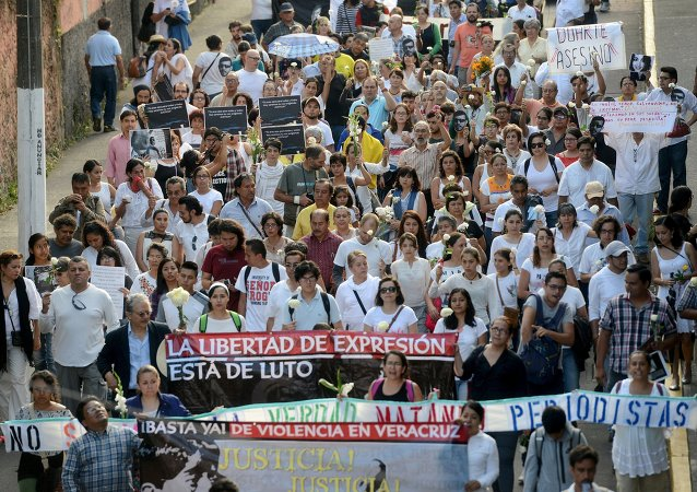 Journalists, activists and civil society members march to demand for justice for the five people killed in the country's capital, including a photojournalist, in Xalapa, Mexico