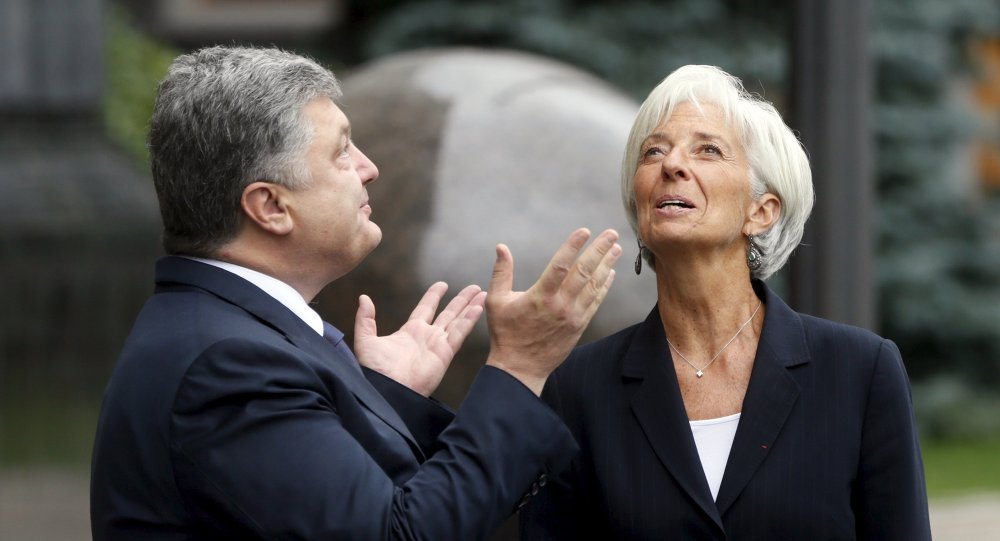 Presidente de Ucrania, Petró Poroshenko y directora del FMI, Christine Lagarde (Archivo)