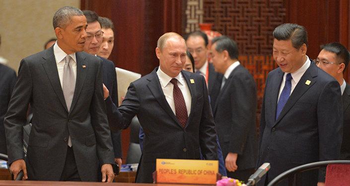 Vladímir Putin, el presidente de Rusia con sus homólogos de EEUU y China