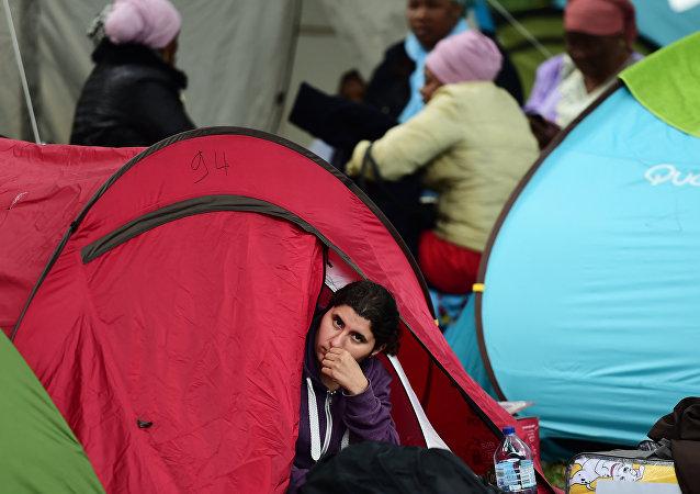Una mujer en el campo de refugiados en Bruselas, Bélgica