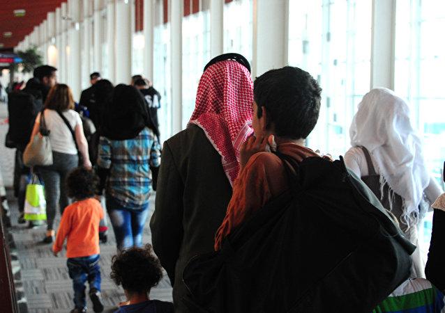 Refugiados sirios en el aeropuerto de Buenos Aires