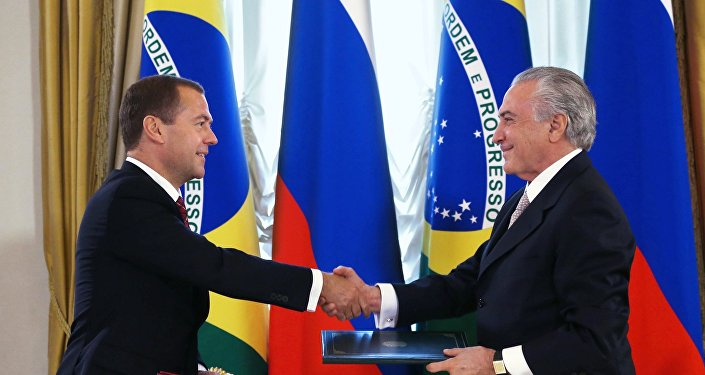 D.Medvedev, primer ministro de Rusia y M. Temer, vicepresidente de Brasil