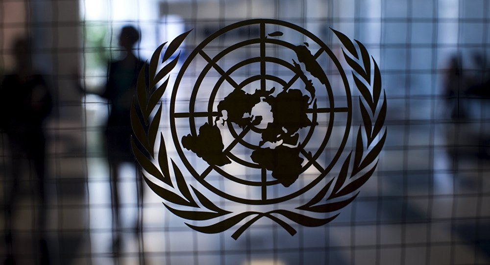 A United Nations logo is seen on a glass door in the Assembly Building at the United Nations headquarters in New York City September 18, 2015