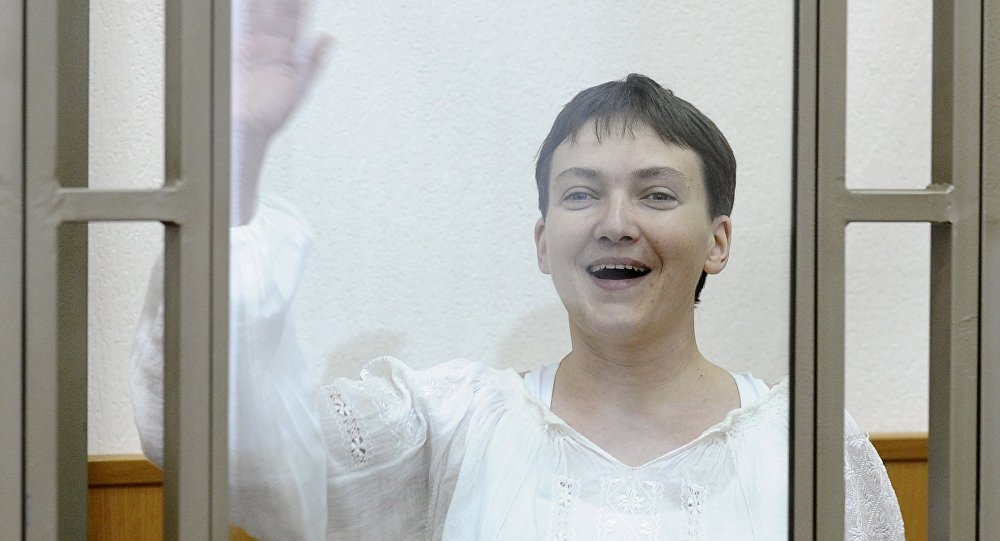 Ukrainian military pilot Nadezhda Savchenko gestures inside a glass-walled cage as she attends a court hearing in the southern border town of Donetsk in Rostov region, Russia, September 29, 2015