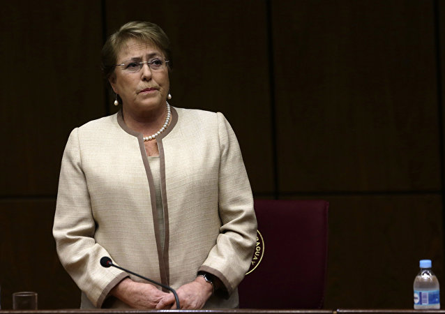 In this Aug. 21, 2015, file photo, Chile's President Michelle Bachelet attends a congressional session, during her official visit, in Asuncion, Paraguay